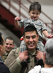 Sgt. Daniel Cruz, of Reno, holds his daughter Hayden, 2, after members of the 422nd Expeditionary Signal Battalion of the Nevada National Guard returned home Sunday, Jan. 15, 2012, after a yearlong deployment to Afghanistan. Hundreds of family and friends greeted the soldiers at the Nevada Air Guard Base in Reno, Nev..Photo by Cathleen Allison