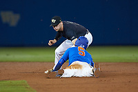 Dalton Guthrie (5) of the Florida Gators is tagged out by Wake Forest Demon Deacons second baseman Jake Mueller (6) during Game Three of the Gainesville Super Regional of the 2017 College World Series at Alfred McKethan Stadium at Perry Field on June 12, 2017 in Gainesville, Florida. The Gators defeated the Demon Deacons 3-0 to advance to the College World Series in Omaha, Nebraska. (Brian Westerholt/Four Seam Images)