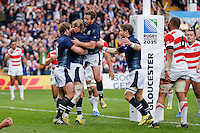 Scotland Fly-Half Finn Russell celebrates with Scrum-Half Greig Laidlaw after scoring a try - Mandatory byline: Rogan Thomson - 23/09/2015 - RUGBY UNION - Kingsholm Stadium - Gloucester, England - Scotland v Japan - Rugby World Cup 2015 Pool B.