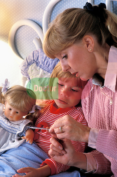 mother sitting at bedside holding oral thermometer talking to her sick young girl in bed holding her doll