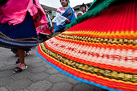 """Young girls, wearing colorful skirts, dance in a procession during the Inti Raymi fiesta in Pichincha province, Ecuador, 27 June 2010. Inti Raymi, """"Festival of the Sun"""" in Quechua language, is an ancient spiritual ceremony held in the Indian regions of the Andes, mainly in Ecuador and Peru. The lively celebration, set by the winter solstice, goes on for various days. The highland Indians, wearing beautiful costumes, dance, drink and sing with no rest. Colorful processions in honor of the God Inti (Sun) pass through the mountain villages giving thanks for the harvest and expressing their deep relation to the Mother Earth (Pachamama)."""
