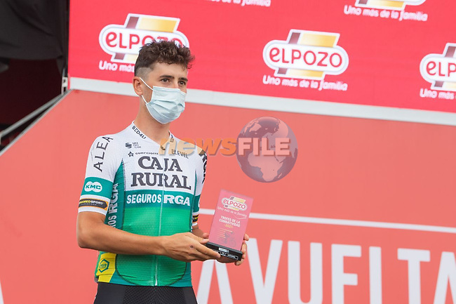 Julen Amezqueta (ESP) Caja Rural-Seguros RGA from yesterday's stage at sign on before Stage 10 of La Vuelta d'Espana 2021, running 189km from Roquetas de Mar to Rincón de la Victoria, Spain. 24th August 2021.     <br /> Picture: Cxcling | Cyclefile<br /> <br /> All photos usage must carry mandatory copyright credit (© Cyclefile | Cxcling)