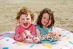 Little Amelia and Lilly Nash enjoying themselves on Banna Beach on Sunday.