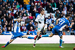 Gareth Bale (C) of Real Madrid fights for the ball with Luis Carlos Correia Pinto, Luisinho (L), and Eduardo Exposito, Edu Exposito, RC Deportivo La Coruna during the La Liga 2017-18 match between Real Madrid and RC Deportivo La Coruna at Santiago Bernabeu Stadium on January 21 2018 in Madrid, Spain. Photo by Diego Gonzalez / Power Sport Images