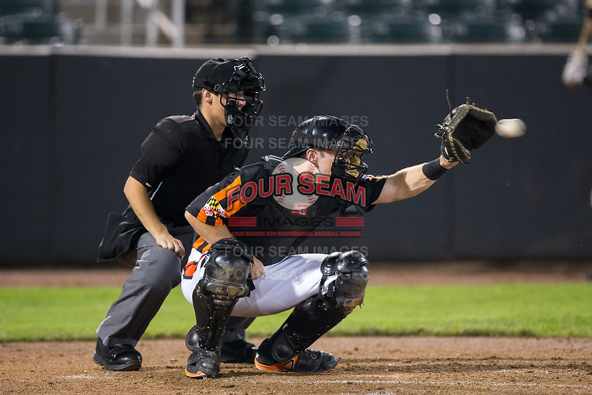 Aberdeen IronBirds catcher Ben Breazeale (39) receives a pitch as home plate umpire Roberto Pattison looks on during the game against the Hudson Valley Renegades at Leidos Field at Ripken Stadium on July 27, 2017 in Aberdeen, Maryland.  The IronBirds defeated the Renegades 3-0 in game two of a double-header.  (Brian Westerholt/Four Seam Images)