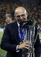 Spain's coach Luis de la Fuente bites the trophy at the end of the Uefa Under 21 Championship 2019 football final match between Spain and Germany at Udine's Friuli stadium, Italy, June 30, 2019. Spain won 2-1.<br /> UPDATE IMAGES PRESS/Isabella Bonotto