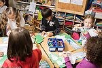 Education Elementary School Grade 2 or Grede 1 children working on projects at tables