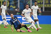 Hakan Calhanoglu of FC Internazionale and Lucas Vazquez of Real Madrid during the Uefa Champions League group D football match between FC Internazionale and Real Madrid at San Siro stadium in Milano (Italy), September 15th, 2021. Photo Andrea Staccioli / Insidefoto