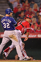 Los Angeles Angels catcher Hank Conger #16 throws to second base while being watched by Texas Rangers outfielder Josh Hamilton #32 at Angel Stadium on September 27, 2011 in Anaheim,California. Texas defeated Los Angeles 10-3.(Larry Goren/Four Seam Images)