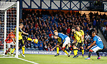 David Bates watches as his goal bound header is cleared off the line