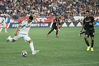 FOXBOROUGH, MA - AUGUST 4: Juan Agudelo #17 of New England Revolution prepares to pass the ball downfield during a game between Los Angeles FC and New England Revolution at Gillette Stadium on August 3, 2019 in Foxborough, Massachusetts.