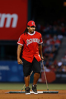 "Justice Cunningham of the Indianapolis Colts, helps the grounds crew drag the infield during a game between the Pittsburgh Pirates and the Los Angeles Angels. Justice is ""Mr Irrelevant"", the tile given to the last draft pick of the 2013 NFL Draft. The game was played at Angel Stadium on June 21, 2013 in Anaheim, California. (Larry Goren/Four Seam Images)"