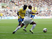 Saturday 28 September 2013<br /> Pictured L-R: Bacary Sagna of Arsenal against Wayne Routledge of Swansea <br /> Re: Barclay's Premier League, Swansea City FC v Arsenal at the Liberty Stadium, south Wales.