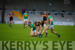 Greg Horan of Austin Stacks retains possession despite the tackle from John Mitchels Patrick Kearney as team mate George Bastible looks on, in the Tralee Town Board Senior Football Championship final.