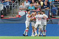 FOXBOROUGH, MA - JULY 7: Yeferson Soteldo #30 of Toronto FC celebrates his goal with teammates during a game between Toronto FC and New England Revolution at Gillette Stadium on July 7, 2021 in Foxborough, Massachusetts.