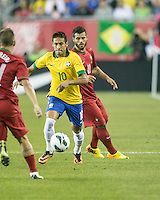 Brazil forward Neymar (10) dribbles the ball down the field.  In an International friendly match Brazil defeated Portugal, 3-1, at Gillette Stadium on Sep 10, 2013.
