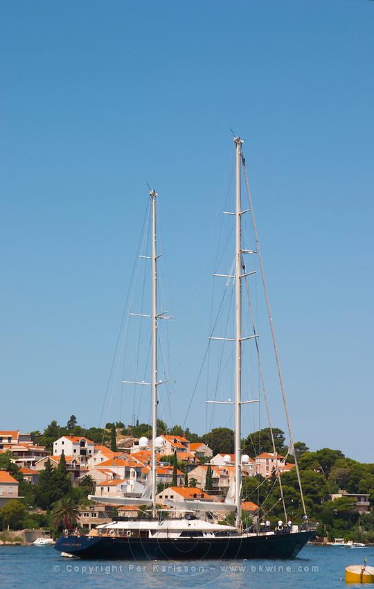 A very big luxurious pleasure sailing ship yacht with two masts, called Santa Maria leaving harbour. Luka Gruz harbour. Babin Kuk peninsula. Dubrovnik, new city. Dalmatian Coast, Croatia, Europe.