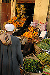 Man selling fruit and vegetables in the Sharia Souk in Luxor.The town of Luxor occupies the eastern part of a great city of antiquity which the ancient Egytians called Waset and the Greeks named Thebes.