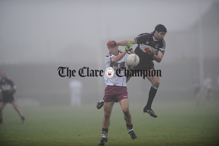 Liscannor's Dara Blake contests a ball with Shane Ryan Of Doonbeg during their semi final at Miltown Malbay. Photograph  by John Kelly.