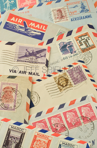 Old Air Mail Envelopes with Cancelled Postage Stamps from around the World<br /> <br /> AVAILABLE FOR COMMERCIAL OR EDITORIAL LICENSING FROM PLAINPICTURE.COM.  Please go to www.plainpicture.com and search for image # p569m791794.