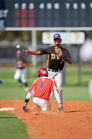 Jondry Vargas (2) throws to first base as Ivan Sosa (1) slides into second base during the Dominican Prospect League Elite Florida Event at Pompano Beach Baseball Park on October 15, 2019 in Pompano beach, Florida.  (Mike Janes/Four Seam Images)
