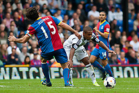 Sun 22 September 2013<br /> <br /> Pictured: Wayne Routledge of Swansea tries to get the ball past Mile Jedinak of Crystal Palace<br /> <br /> Re: Barclays Premier League Crystal Palace FC  v Swansea City FC  at Selhurst Park, London