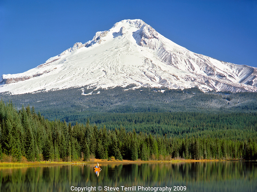 Fishing in Trillium Lake with Mt Hood relfecting on surface in Clackamas County Oregon