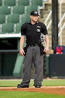 Home plate umpire Travis Godec between innings of the South Atlantic League game between the Greenville Drive and the Kannapolis Intimidators at CMC-Northeast Stadium on June 29, 2013 in Kannapolis, North Carolina.  The Intimidators defeated the Drive 9-3 in the completion of the game that began on June 28, 2013.   (Brian Westerholt/Four Seam Images)