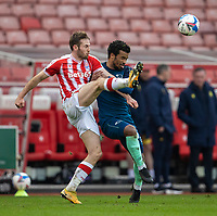 20th March 2021; Bet365 Stadium, Stoke, Staffordshire, England; English Football League Championship Football, Stoke City versus Derby County; Rhys Norrington-Davies of Stoke City clears the ball away from Nathan Byrne of Derby County