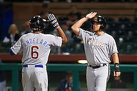 Mesa Solar Sox third baseman Jeimer Candelario (6) high fives Austin Dean after a home run during an Arizona Fall League game against the Scottsdale Scorpions on October 20, 2015 at Scottsdale Stadium in Scottsdale, Arizona.  Mesa defeated Scottsdale 5-4.  (Mike Janes/Four Seam Images)