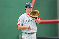 Lakewood BlueClaws catcher Andrew Knapp (16) warms up in the outfield prior to the game against the Kannapolis Intimidators at CMC-NorthEast Stadium on July 20, 2014 in Kannapolis, North Carolina.  The Intimidators defeated the BlueClaws 7-6. (Brian Westerholt/Four Seam Images)