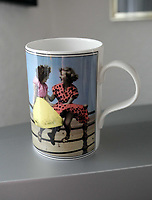 Pictured: A coffee mug with one of the images Bert Hardy took in Blackpool. <br /> Re: 77 year old Pat Stewart (nee Wilson) who now lives near Llantwit Major in the Vale of Glamorgan, south Wales claims she is one of the two young ladies in an iconic image taken by photographer Bert Hardy at Blackpool Promenade in July 1951, alongside fellow Tiller girl Wendy Clarke. Stewart is alleging that another woman, Norma Edmondson who has been claiming that it is her in the picture, is a fraud.<br /> THE COPYRIGHT OF THE IMAGE ON THE ITEM DEPICTED BELONGS TO BERT HARDY / GETTY IMAGES AND IS ONLY SUPPLIED TO SUPPORT PAT STEWART'S CLAIMS