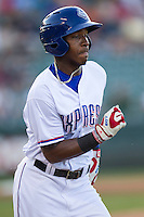 Round Rock Express shortstop Yeyson Yrizarri (60) runs to first base during the Pacific Coast League baseball game against the Oklahoma City Dodgers on June 9, 2015 at the Dell Diamond in Round Rock, Texas. The Dodgers defeated the Express 6-3. (Andrew Woolley/Four Seam Images)