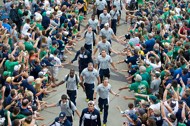Aug. 31, 2013;  Notre Dame football players enter Notre Dame Stadium before the season opener against Temple. Photo by Barbara Johnston/University of Notre Dame