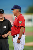 State College Spikes manager Joe Kruzel (13) talks with umpire Roberto Pattison before a game against the West Virginia Black Bears on August 30, 2018 at Medlar Field at Lubrano Park in State College, Pennsylvania.  West Virginia defeated State College 5-3.  (Mike Janes/Four Seam Images)