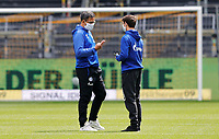 16th May 2020, Signal Iduna Park, Dortmund, Germany; Bundesliga football, Borussia Dortmund versus FC Schalke;  S04 Trainer David Wagner chats with S04 Benito Raman in a Mask per the new DFL Ruleand