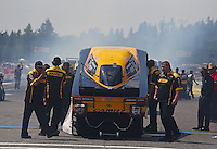 Aug. 2, 2014; Kent, WA, USA; Crew members for NHRA funny car driver Del Worsham during qualifying for the Northwest Nationals at Pacific Raceways. Mandatory Credit: Mark J. Rebilas-