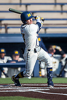 Michigan Wolverines third baseman Christian Molfetta (14) follows through on his swing during the NCAA baseball game against the Illinois Fighting Illini at Fisher Stadium on March 19, 2021 in Ann Arbor, Michigan. Illinois won the game 7-4. (Andrew Woolley/Four Seam Images)
