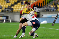 Wes Goosen of the Hurricanes is tackled by George Worth of the Melbourne Rebels during the Super Rugby - Hurricanes v Rebels at Sky Stadium, Wellington, New Zealand on Friday 21 May 2021.<br /> Photo by Masanori Udagawa. <br /> www.photowellington.photoshelter.com