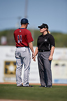 Mahoning Valley Scrappers manager Luke Carlin (11) talks with first base umpire Jennifer Pawol during the first game of a doubleheader against the Batavia Muckdogs on September 4, 2017 at Dwyer Stadium in Batavia, New York.  Mahoning Valley defeated Batavia 4-3.  (Mike Janes/Four Seam Images)