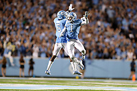 CHAPEL HILL, NC - SEPTEMBER 07: Myles Dorn #1 and Patrice Rene #5 of the University of North Carolina celebrate stopping a Miami drive during a game between University of Miami and University of North Carolina at Kenan Memorial Stadium on September 07, 2019 in Chapel Hill, North Carolina.