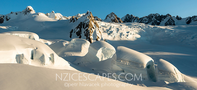 Huge seracs and crevasses of upper parts of Franz Josef Glacier at sunset, Westland Tai Poutini National Park, West Coast, UNESCO World Heritage Area, New Zealand, NZ