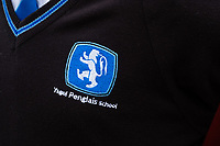 "COPY BY TOM BEDFORD<br /> Pictured: Detail on a school uniform of a pupil at Ysgol Penglais School in Aberystwyth, Wales, UK<br /> Re: More than 400 pupils at a comprehensive school in Aberystwyth were given detention on their first day back for breaking school uniform rules.<br /> The uniform was changed at Ysgol Penglais over the summer, following a consultation.<br /> But a number of parents have complained to the school and some 250 have signed a petition saying the punished pupils were ""treated unfairly"".<br /> Ceredigion council said a large number of pupils were kept in at break times.<br /> The new uniform was brought in for the start of the new academic year, with the old navy blue pullover and white polo shirt replaced by a grey v-neck jumper, white shirt and a tie. Sixth formers have a similar outfit.<br /> It is compulsory for all pupils in years 7 and 12 to wear the new uniform, with other students being given the rest of the year to buy it.<br /> This was outlined in correspondence sent to all parents over the summer months, which also stipulated what trousers, skirts and shoes would be deemed acceptable.<br /> But the petition said the new rules were not clear enough and that the pupils should not have been punished for their parents' mistakes.<br /> It also said a warning should have been given before the detention."