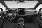 Stock photo of straight dashboard view of 2021 Toyota Corolla-Hatchback SE 5 Door Hatchback Dashboard