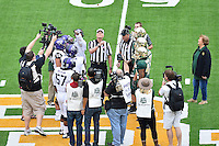 Referee Randy Christal performs ceremonial coin toss before an NCAA football game kickoff, Saturday, October 11, 2014 in Waco, Tex. Baylor defeated TCU 61-58 to remain undefeated in BIG 12 conference. (Mo Khursheed/TFV Media via AP Images)