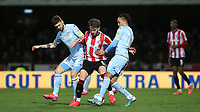Mateusz Klich and Helder Costa of Leeds United combine to challenge Brentford's Mathas Jensen during Brentford vs Leeds United, Sky Bet EFL Championship Football at Griffin Park on 11th February 2020