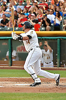John Buck (14) of the Salt Lake Bees at bat against the Reno Aces in Pacific Coast League action at Smith's Ballpark on July 24, 2014 in Salt Lake City, Utah.  (Stephen Smith/Four Seam Images)