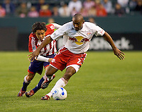 Red Bulls Def. Marvell Wynne reaches for a loose ball against CD Chivas USA Mid. Francisco Mendoza during a 0-0 ties between the Chivas USA vs NY Red Bulls in a MLS game at The Home Depot Center in Carson, California Saturday, April, 29, 2006.