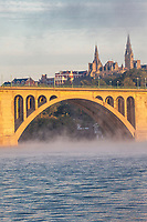 Key Bridge over the Potomac River in Early Morning Fog, Looking toward Georgetown University on right, Washington DC, USA.