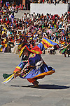 """A monk perfoms during annual Thimpu Tshechu. The Tshechu is a festival honouring Guru Padmasambhava, """"one who was born from a lotus flower."""" This Indian saint contributed enormously to the diffusion of Tantric Buddhism in the Himalayan regions of Tibet, Nepal, Bhutan etc. around 800 AD. He is the founder of the Nyingmapa, the """"old school"""" of Lamaism which still has numerous followers. The biography of Guru is highlighted by 12 episodes of the model of the Buddha Shakyamuni's life. Each episode is commemorated around the year on the 10th day of the month by """"the Tschechu"""". The dates and the duration of the festivals vary from one district to another but they always take place on or around the 10th day of the month according to the Bhutanese calendar. During Tshechus, the dances are performed by monks as well as by laymen. The Tshechu is a religious festival and by attending it, it is believed one gains merits. It is also a yearly social gathering where the people, dressed in all their finery, come together to rejoice. Arindam Mukherjee."""